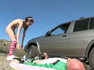 Cute brunette teen giving old fart a hot blowjob outdoors